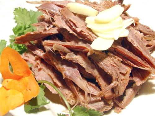 На фото: собачье мясо pei  xian gou rou